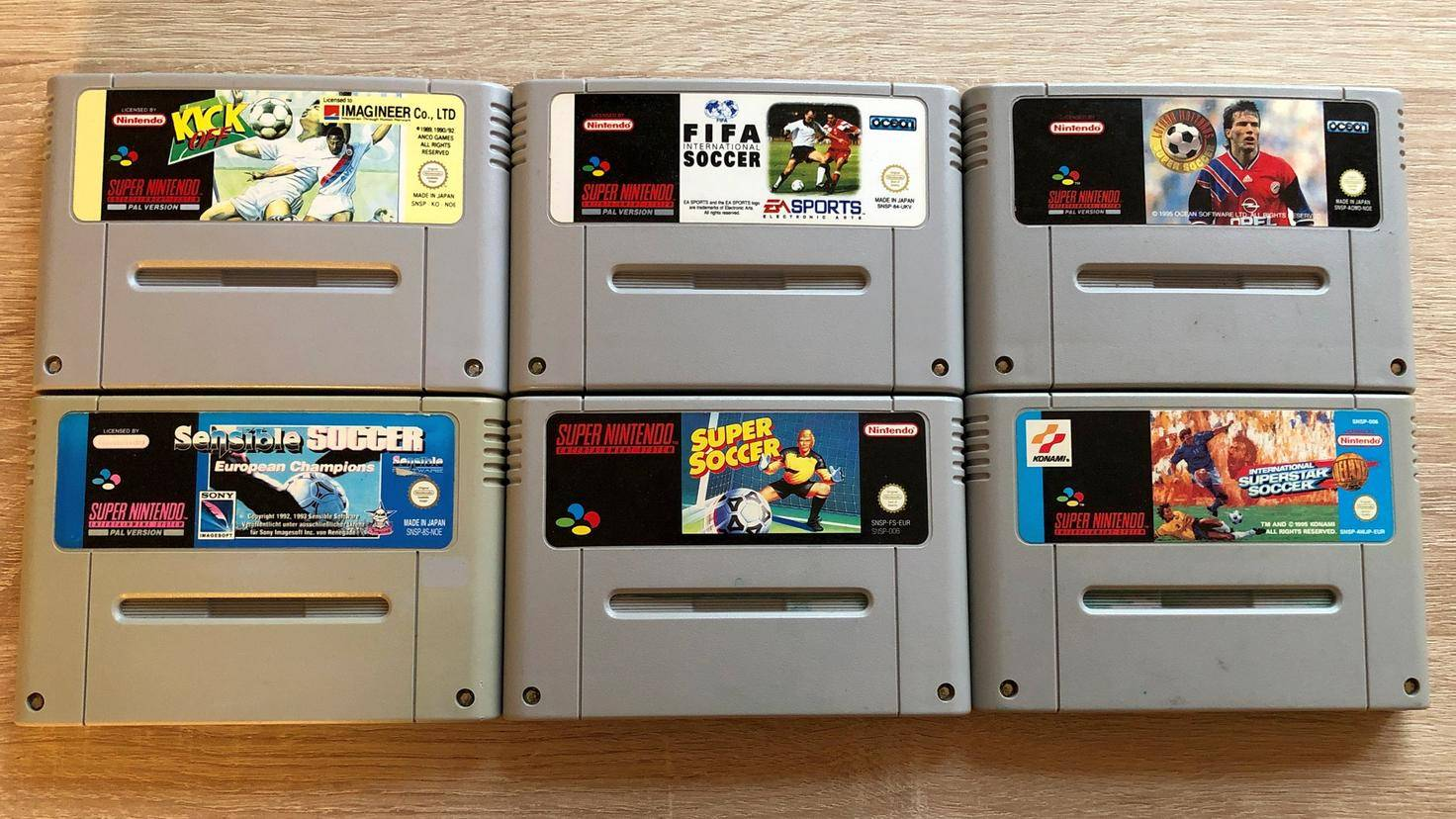 Super Nintendo Football Video Game Cartridges: Kick Off, FIFA, Lothar Matthaus Super Soccer, Sensible Soccer, Super Soccer, International Superstar Soccer Deluxe.
