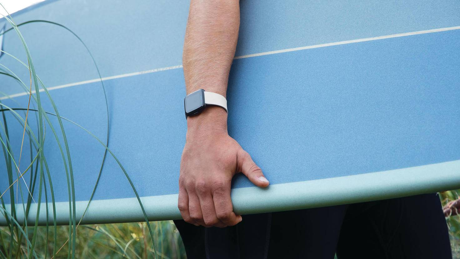 The Fitbit Versa or Fitbit Versa Lite can be easily taken to surf.