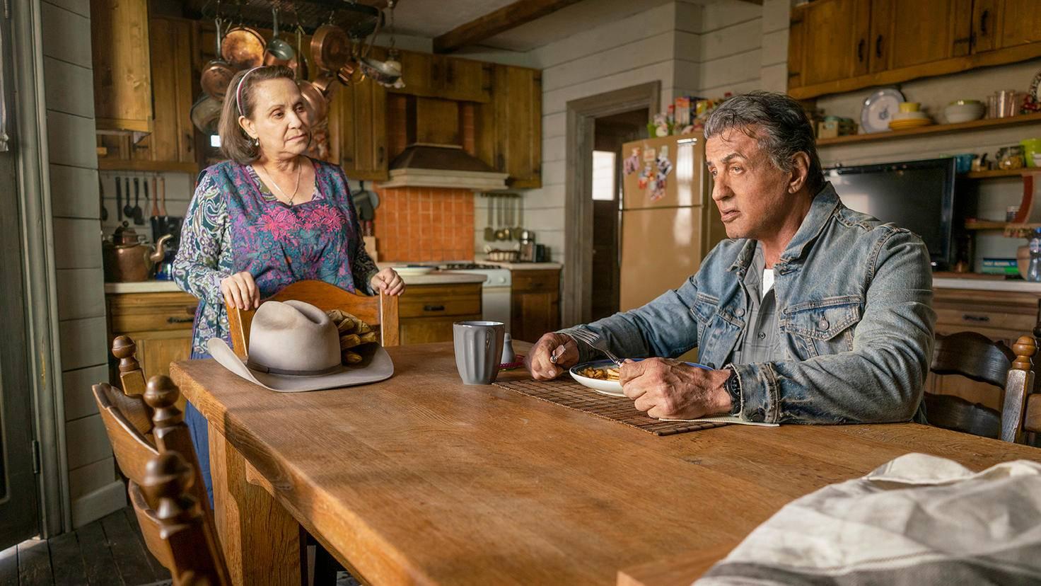 "Adriana Barraza as Maria Beltran and Sylvester Stallone as John Rambo in ""Rambo: Last Blood"""