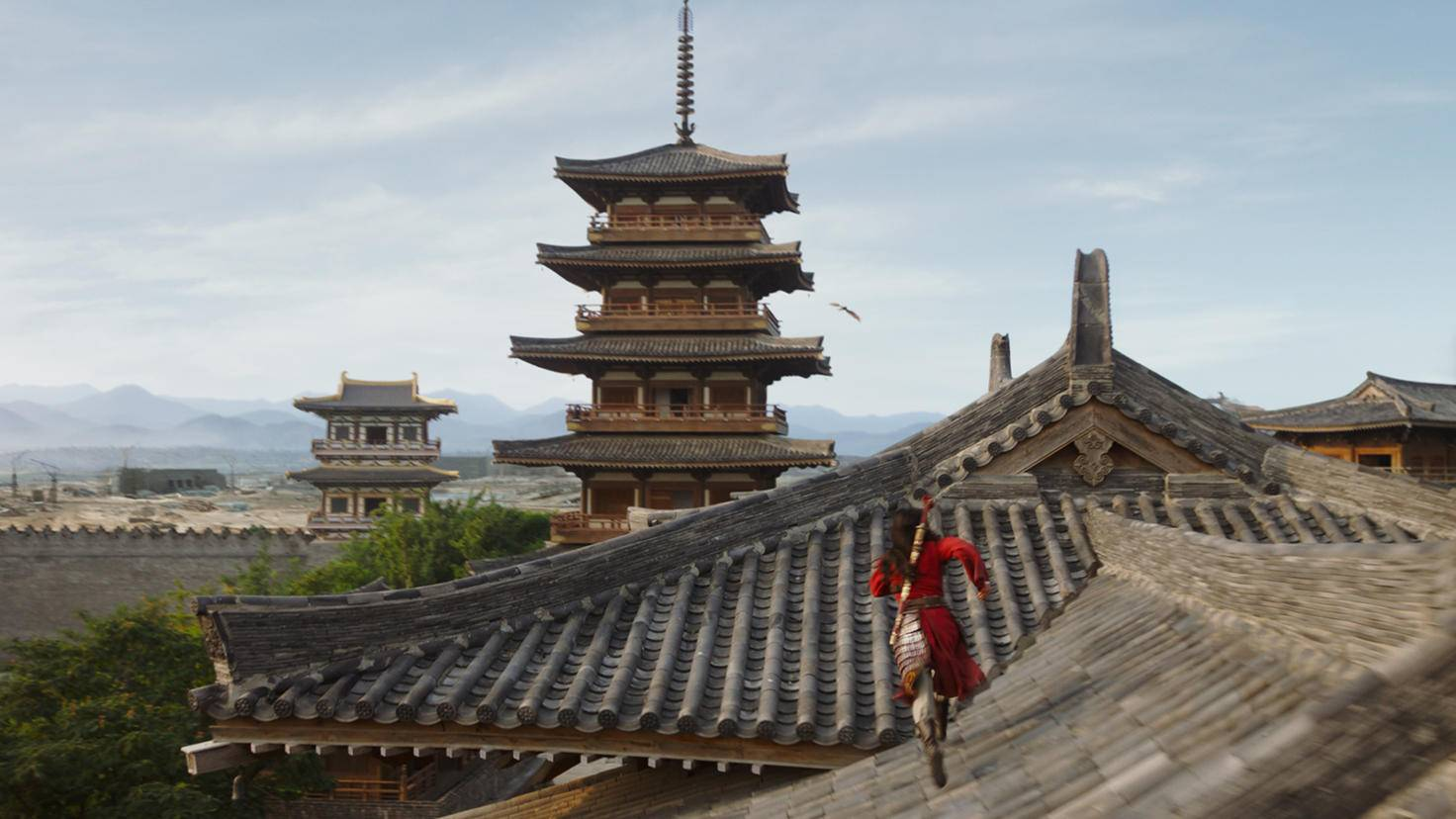 Mulan takes up chase on the rooftops of the capital.