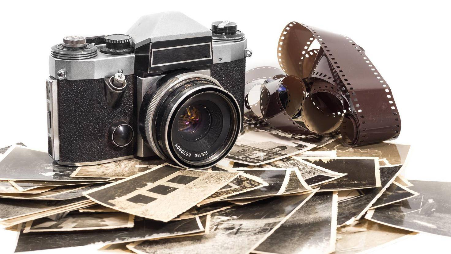 old antique camera with photographs